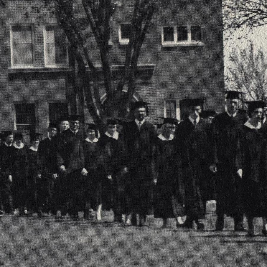 A black and white photo of a graduation ceremony