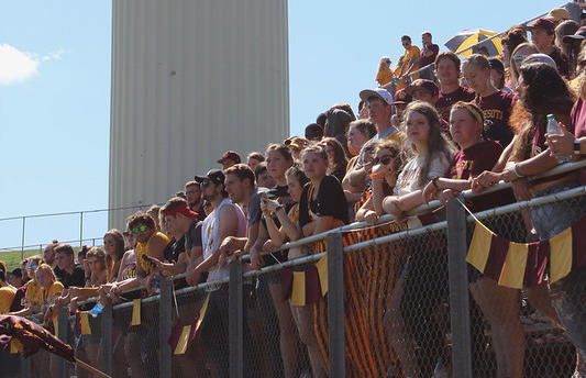 Students enjoying the Homecoming football game.